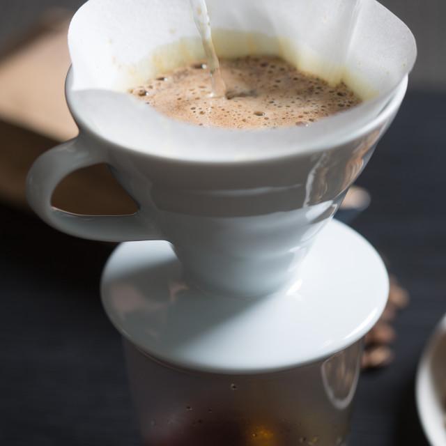 """Preparing coffee in a manual filter"" stock image"