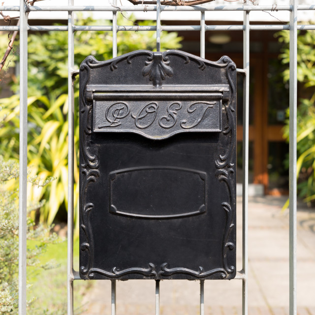 """Close up Black Metal Post Box Hanging on Railings"" stock image"