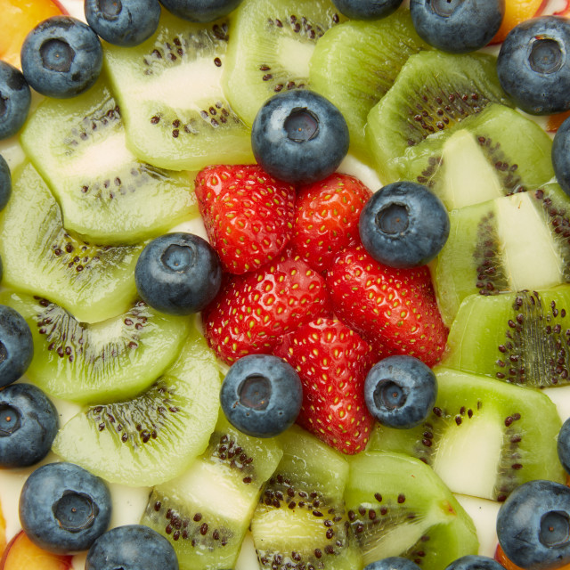 """Berries, Apples and Kiwis on Top of Tasty Cake"" stock image"