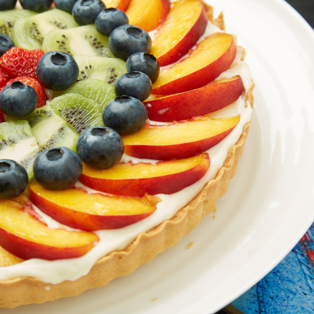 """Mouth Watering Cake with Fresh Fruits on a Plate"" stock image"