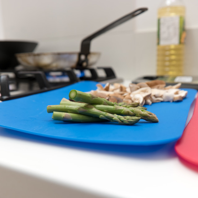 """Fresh asparagus tips and mushrooms on a board"" stock image"