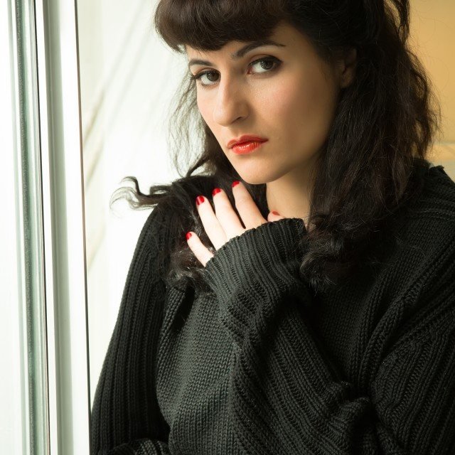 """Melancholic Girl at the Window"" stock image"