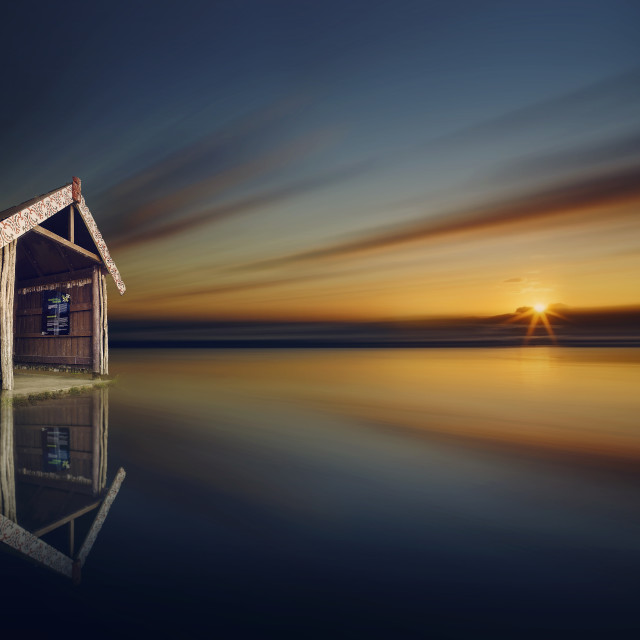 """""""Lonely hut and the sunset over a beach"""" stock image"""