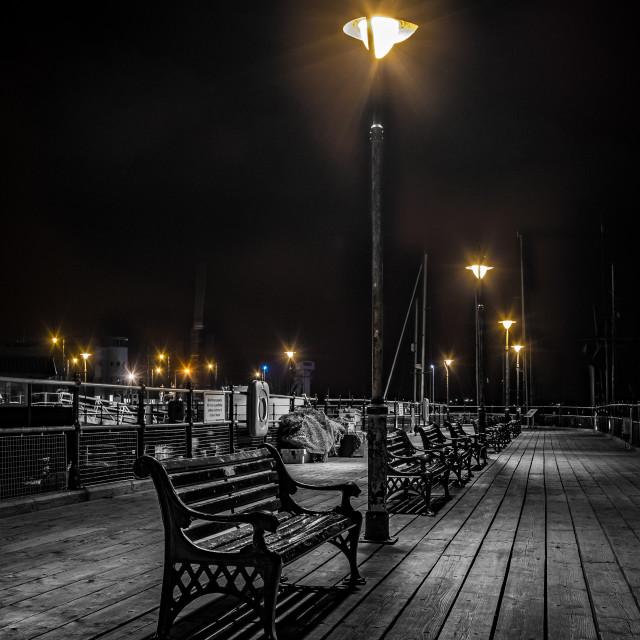 """Sitting Under Halfpenny Pier Light"" stock image"