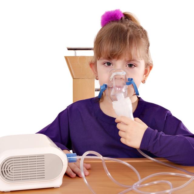 """little girl taking inhaled"" stock image"