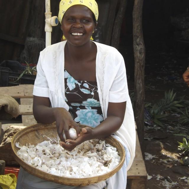 """Saleswoman of garlic"" stock image"