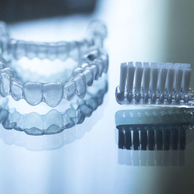 """Invisible dental teeth brackets aligners retainers and toothbrush"" stock image"