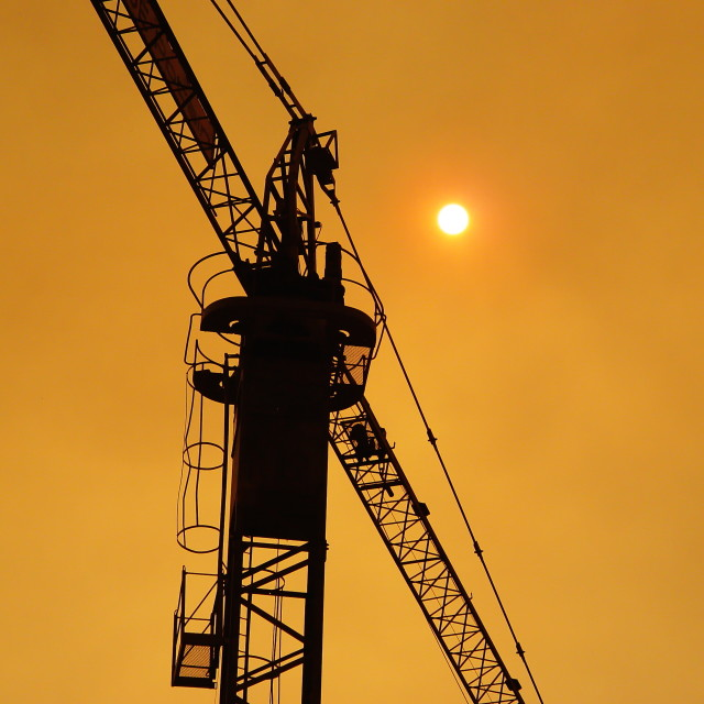 """Crane on fire"" stock image"