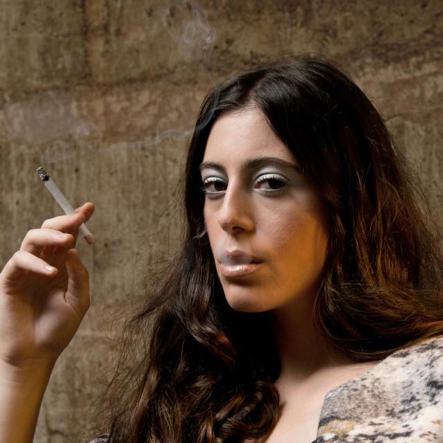 """young woman smoking cigarette"" stock image"