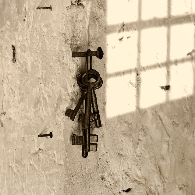 """Key hanging on the wall"" stock image"