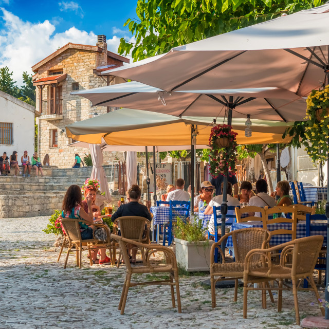 """Street cafe's with tourists in Omodos village. Limassol District, Cyprus"" stock image"
