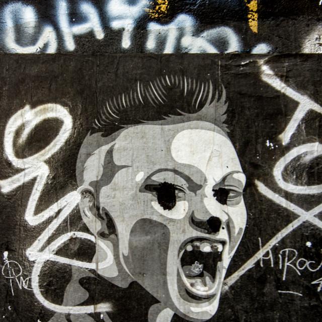 """Angry graffiti on a dutch wall"" stock image"