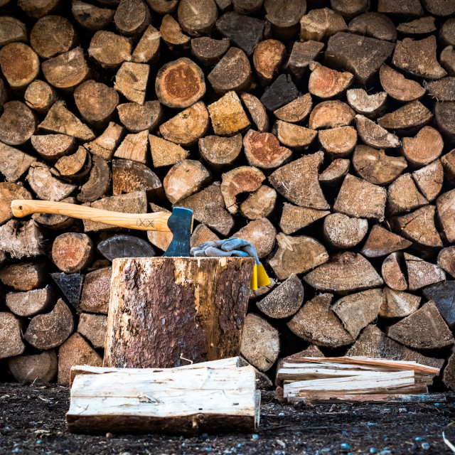 """""""Axe (with work gloves), split wood, kindling, with a stacked firewood background"""" stock image"""