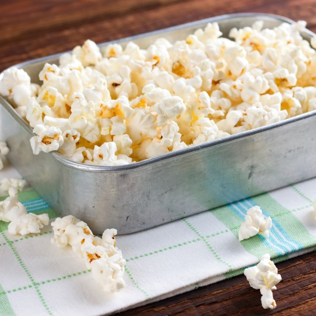 """Rustic aluminum pan with popcorn"" stock image"