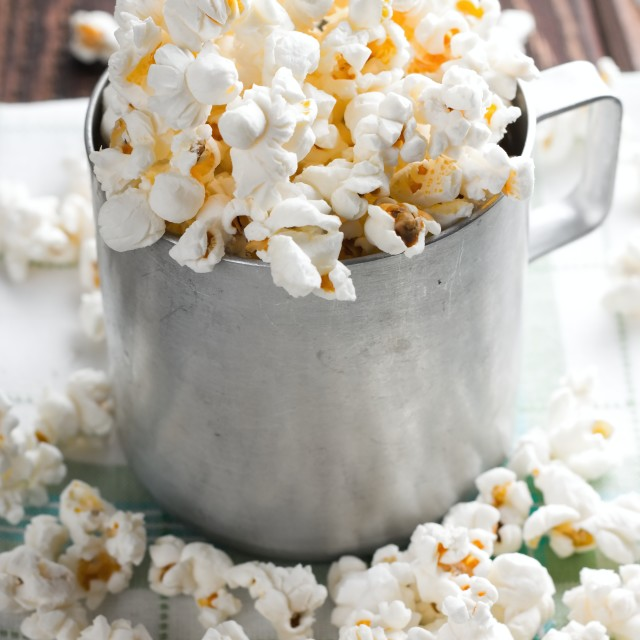 """""""Salty white popcorn in old cup"""" stock image"""