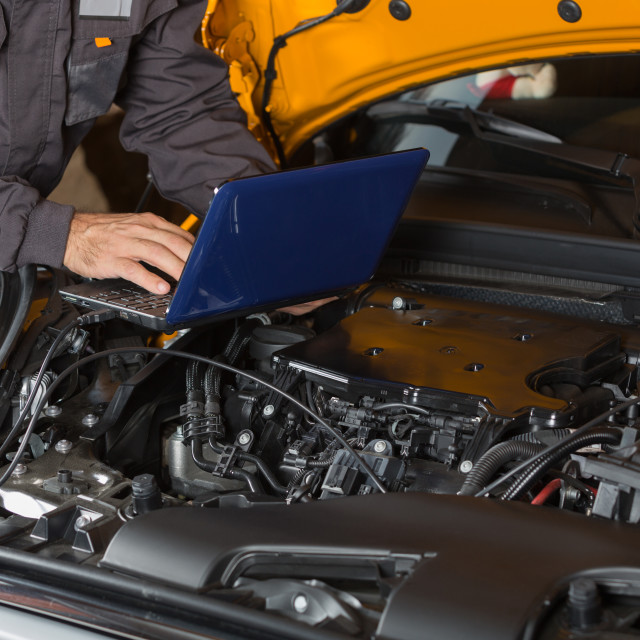 """Car mechanic with a tablet"" stock image"