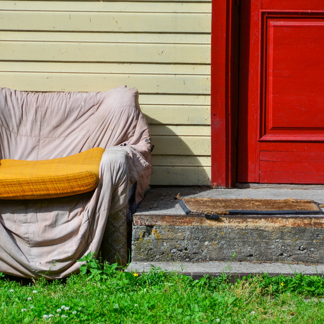 """Shabby chair outside of house"" stock image"