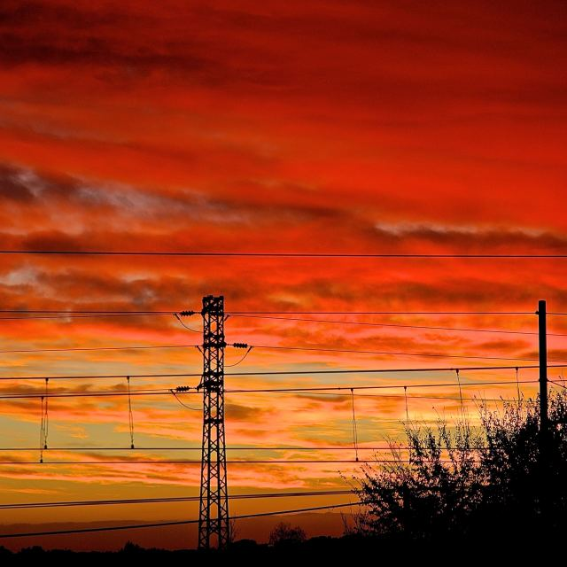 """Sunset with electric cables"" stock image"