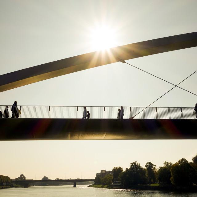 """Pedestrian bridge at sunset"" stock image"
