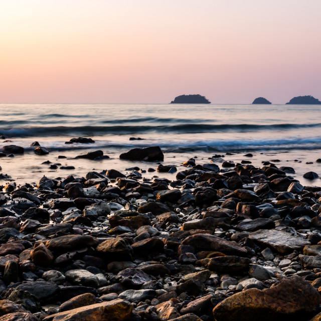 """Rocky beach in sunset"" stock image"