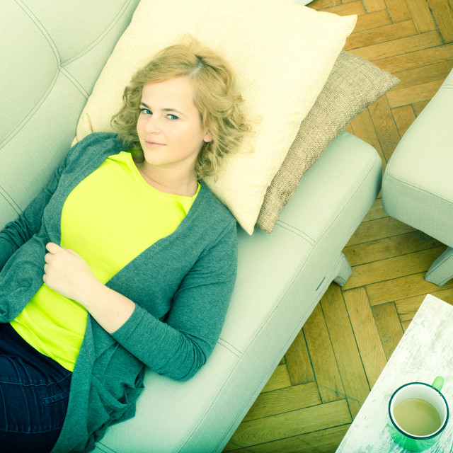 """Young woman on the sofa with Gadgets"" stock image"