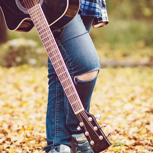 """""""Young girl with guitar"""" stock image"""