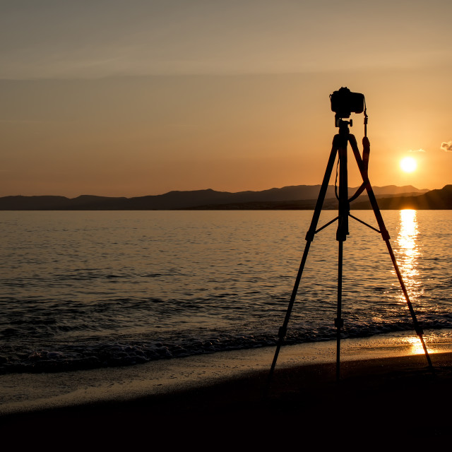 """""""Silhouette of a camera and tripod at sunset on the island of Rho"""" stock image"""