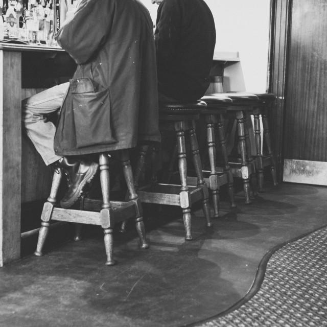 """Men at a bar"" stock image"