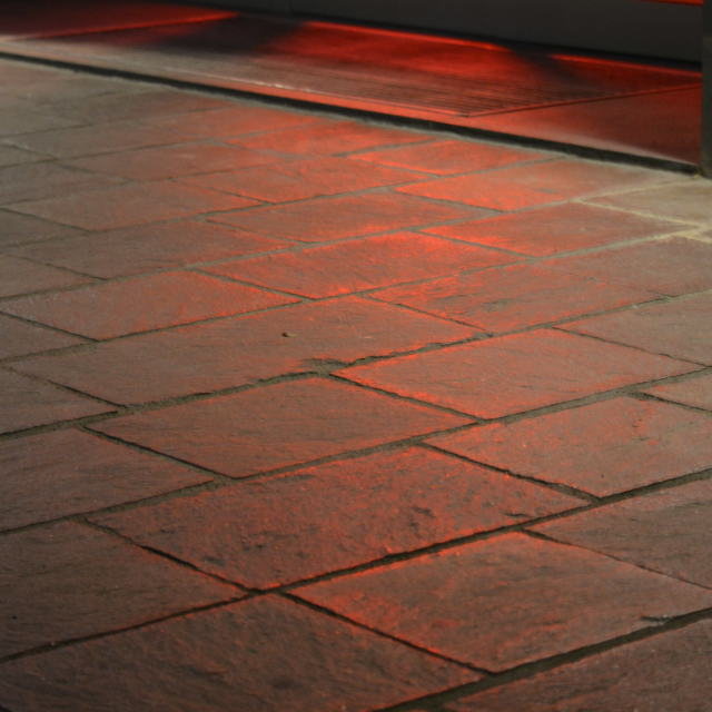 """""""Red light ferlecting on pavement"""" stock image"""