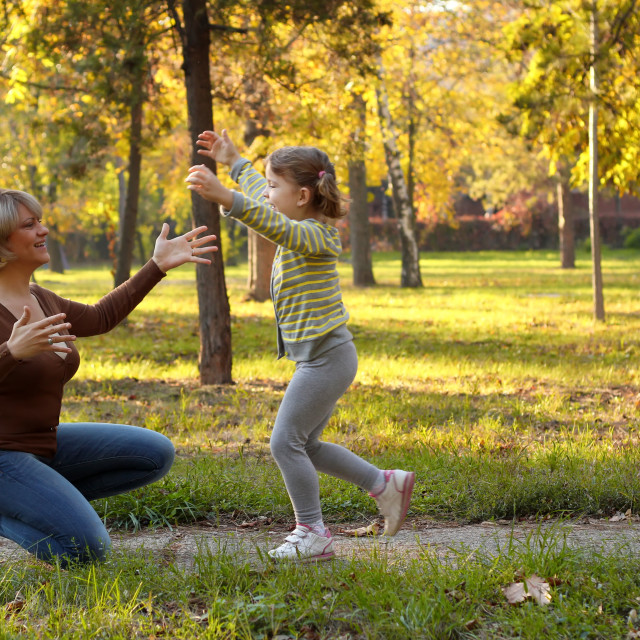 """little girl running to embrace mother"" stock image"