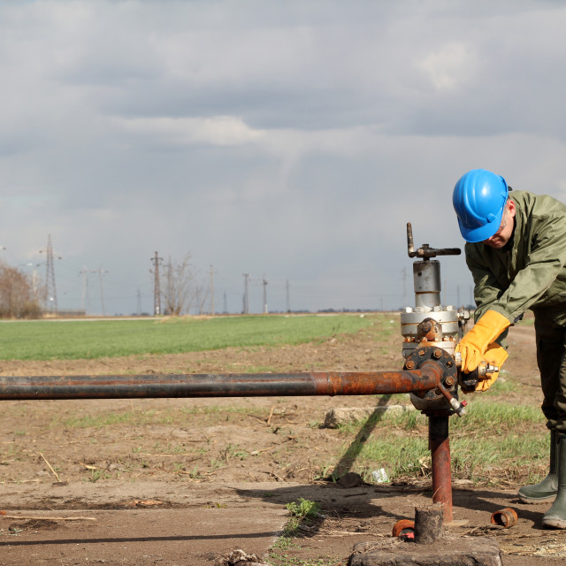 """""""oil worker closes the valve"""" stock image"""