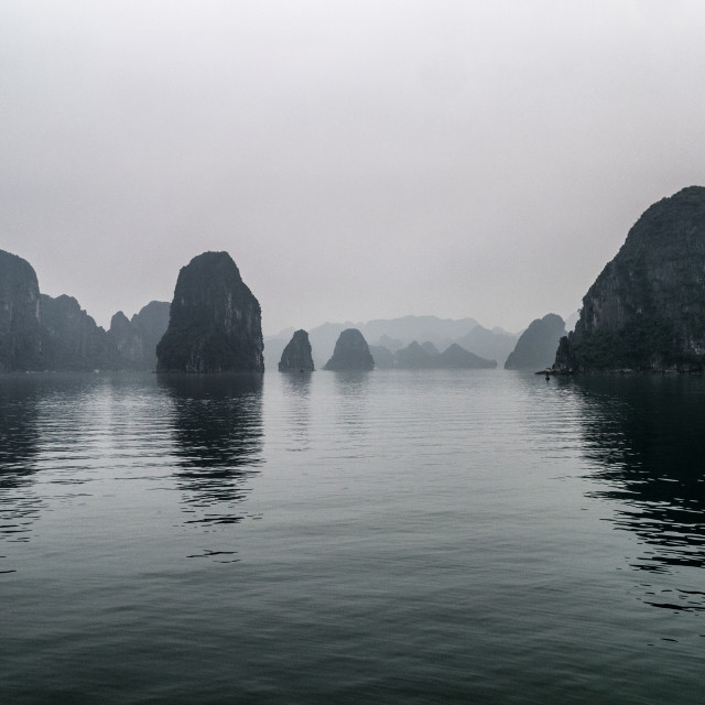 """Misty Halong Bay Rock Islands, Vietnam"" stock image"