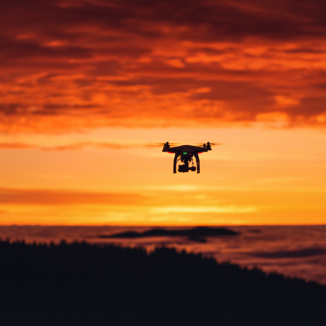 """A personal drone flying through the air"" stock image"