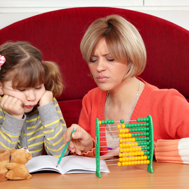 """""""unhappy daughter and mother doing homework"""" stock image"""
