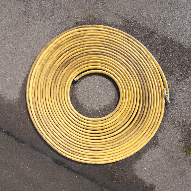 """coiled water hosepipe"" stock image"