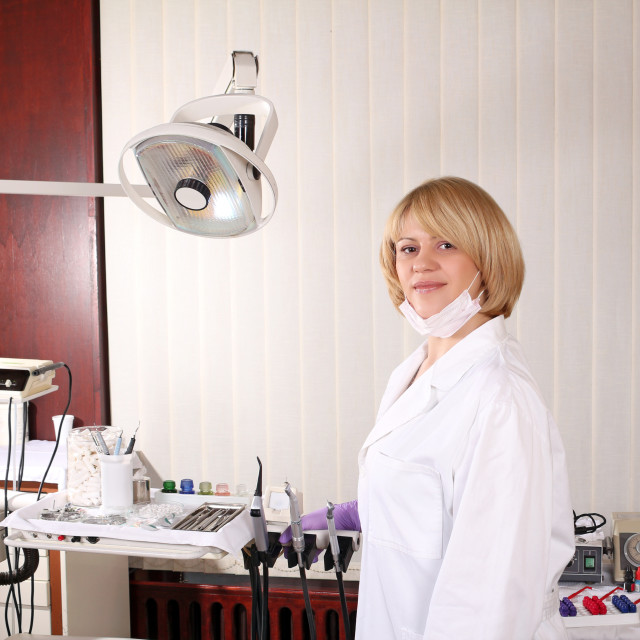 """female dentist with equipment in dentist office"" stock image"