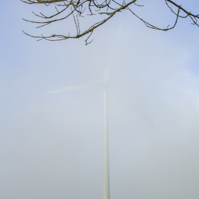 """Windturbine in the fog"" stock image"