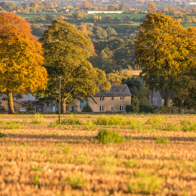 """Sunshine Autumn over Wiltshire Cottage & landscape, Monkton Farleigh"" stock image"