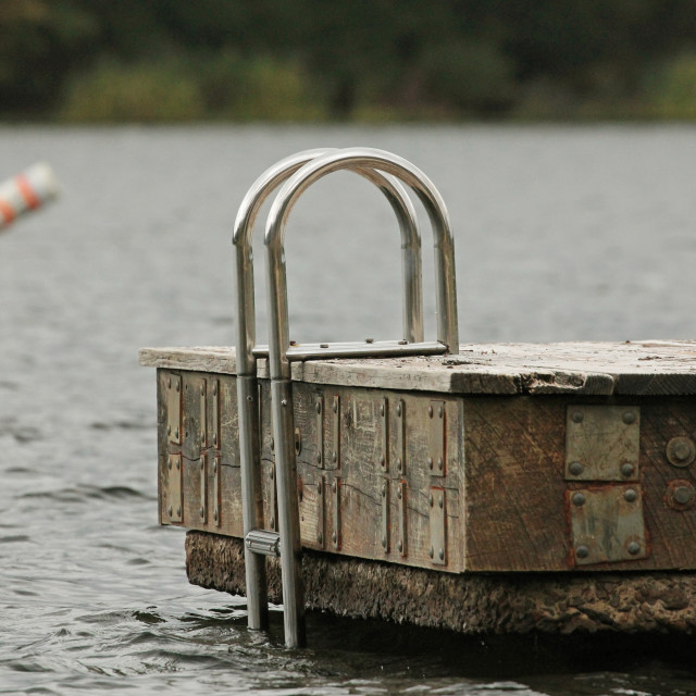 """Summer's end and an empty swimming dock"" stock image"