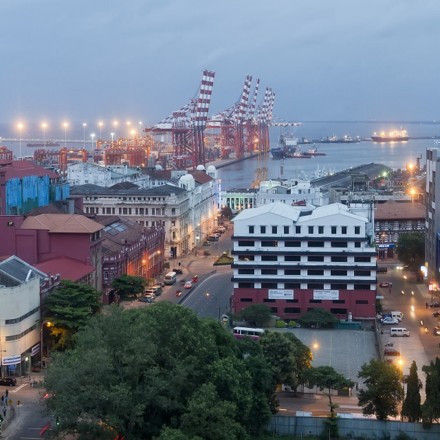 """""""View on Colombo port and city in Sri Lanka at dusk."""" stock image"""