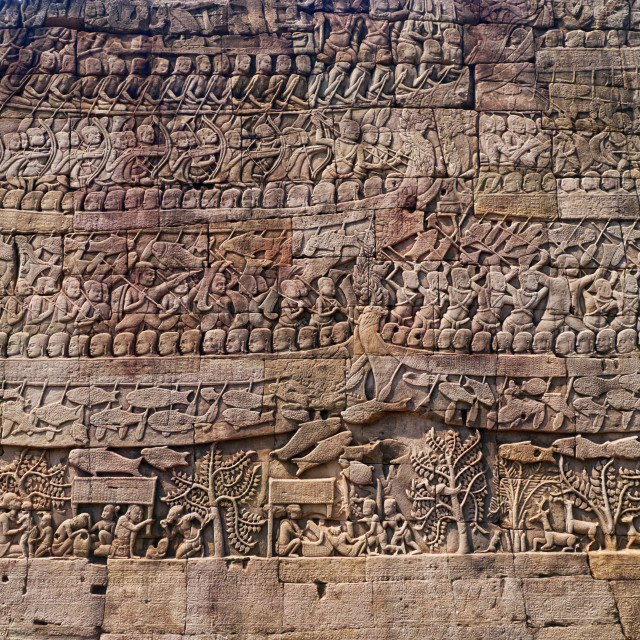 """Wall Carving Art Scene, Bayon Temple, Siem Reap"" stock image"