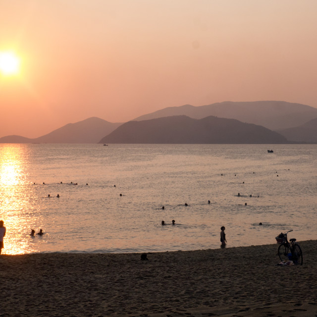 """Beach and Sea at Sunrise, Nha Trang, Vietnam"" stock image"