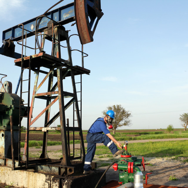 """""""oil worker with gas mask check pipeline"""" stock image"""