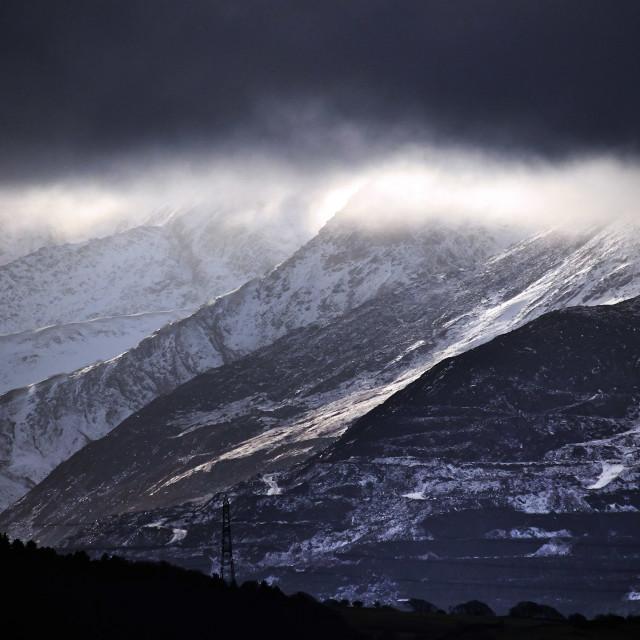 """A brooding monochromatic mountain landscape"" stock image"