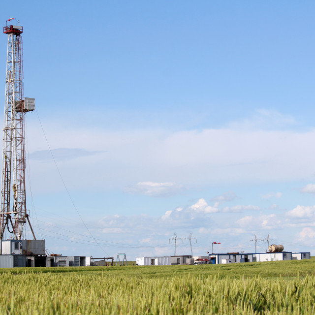 """""""field with oil drilling rig"""" stock image"""