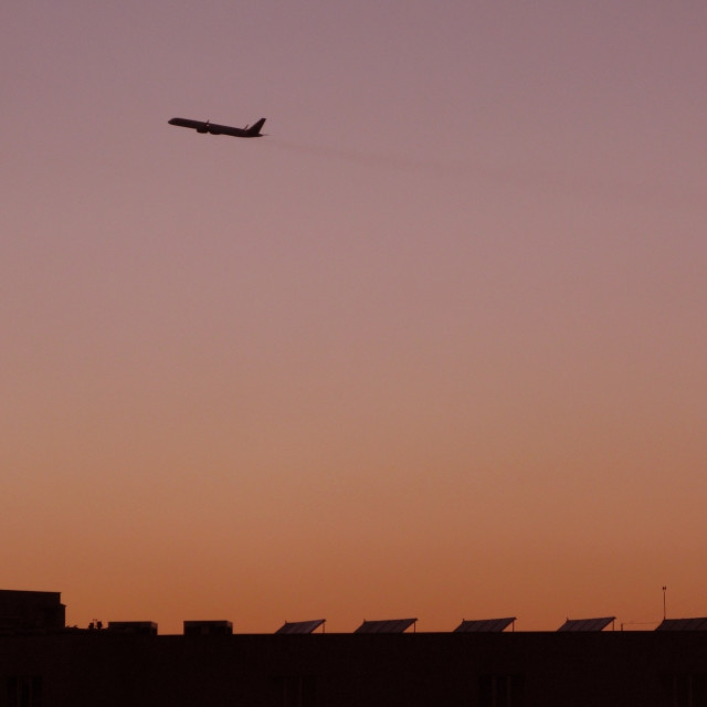 """Airplane takeoff at dusk"" stock image"