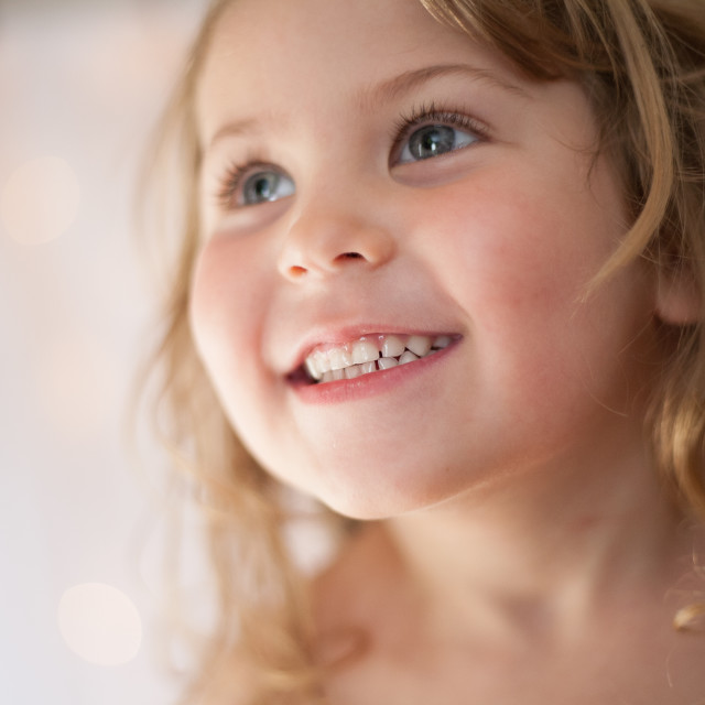 """Young girl smiling"" stock image"