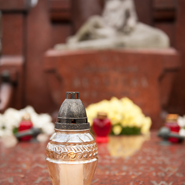"""Transparent votive candle on grave"" stock image"
