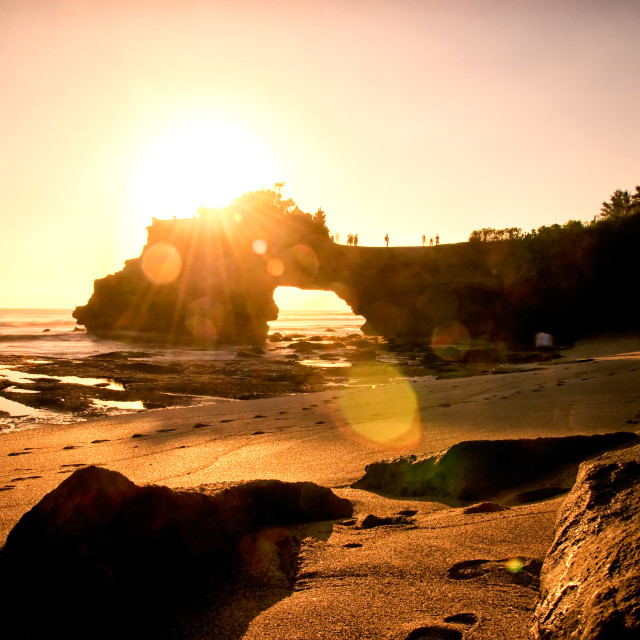 """Sunset over stone gate at Tanah Lot temple, Bai island, Indonesia"" stock image"