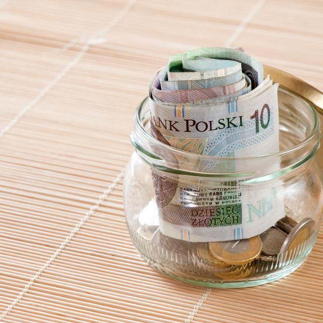 """Money savings in glass jar"" stock image"